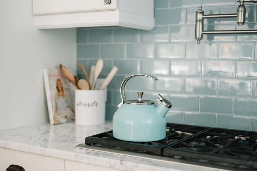 A tea kettle in a fun color is an easy way to add a splash of color to your summer decor