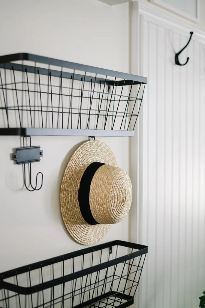 A straw hat hangs in the entryway, a classic sign of summer