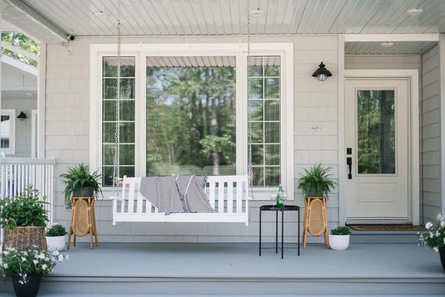 Summer front porch inspiration - porch swing, greenery and white blooms