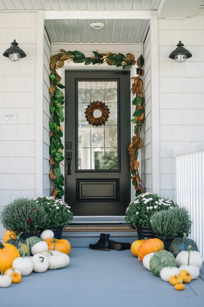 Fall Front porch decked out with magnolia garland and pumpkins!