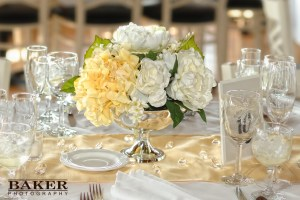Reception table with flowers - Photo credit Baker Photography