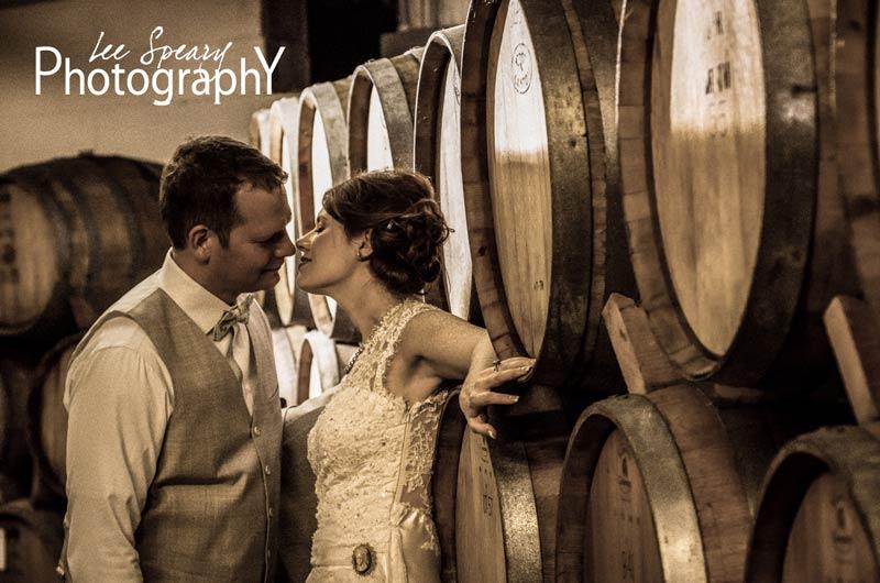 Bride & Groom in Wine Cellar