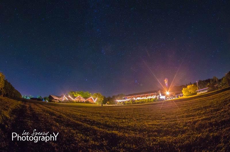 Lit buildings under starry sky