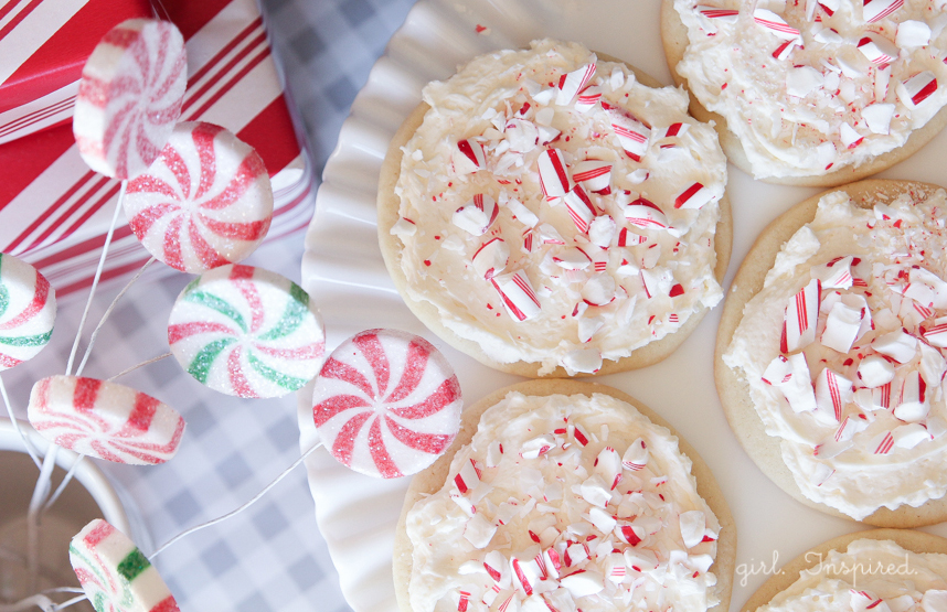Candy Cane Cookies - sugar cookies topped with Peppermint Marshmallow Frosting and Candy Cane bits!