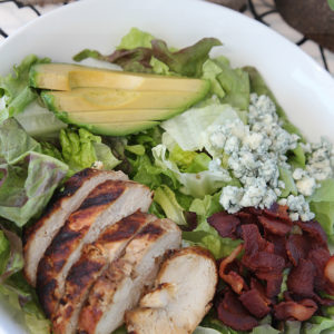 Delicious chicken chopped salad with recipes for grilled chicken and cilantro-lime dressing.