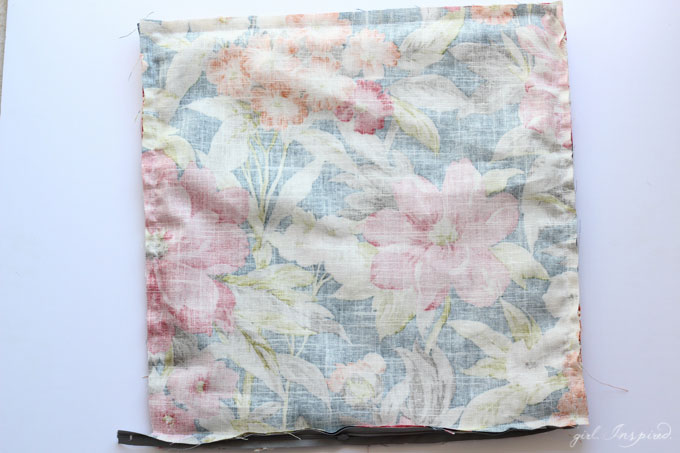 two squares of fabric sewn together and inside out.