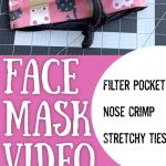 Cat Pattern on pink face mask on grey and white sewing cut mat with text overlay