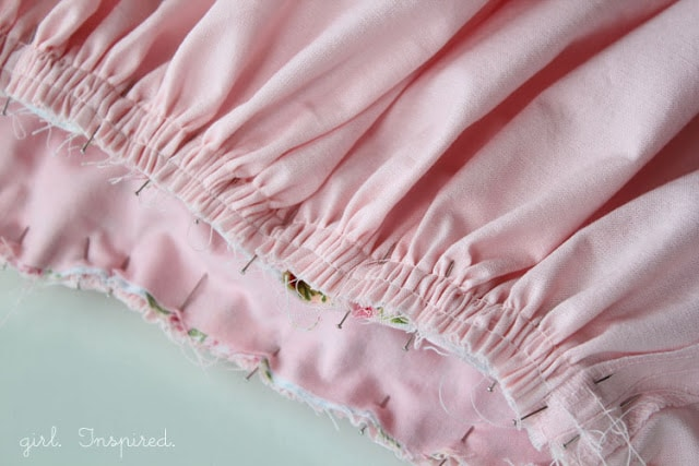 pink fabric gathered and pinned
