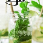 mint leaves and bamboo straw in mason jar mojito with text overlay