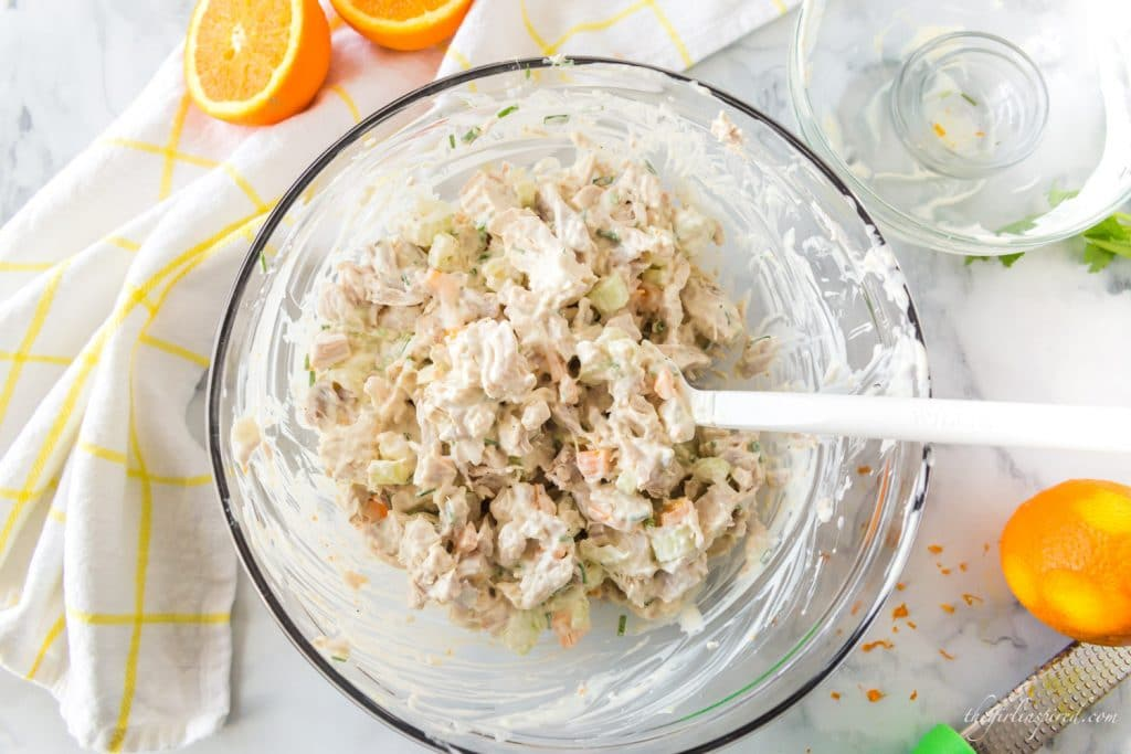 spatula and stirred chicken salad in glass bowl