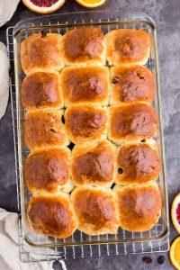 golden brown hot cross buns in baking dish