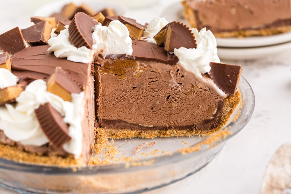 Glass pie dish filled with three quarters of Peanut Butter Ice Cream Pie