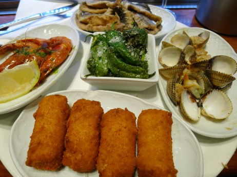 The next night, at Cuidad Condal, even with an English menu, I didn't understand all the dishes, so I just ordered an assorted tapas platter. Clockwise: fried anchovies, clams in garlic sauce, ham croquettes, grilled prawns (gambas roja) and at center, grilled Padron peppers with sea salt. I loved everything! The croquettes were the best I had on the trip, the clams I could have eaten plates of and I even ate and enjoyed the peppers, which is unusual for me. Top meal for sure! I also met some friendly Americans from Texas, though the bar was full of a mix of locals and tourists.