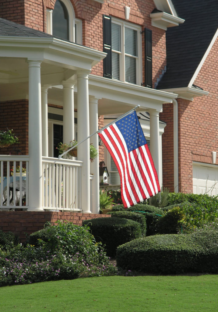 Luxury Home Exterior front view with American Flag
