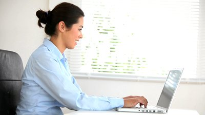 business-woman-working-with-her-laptop-in-her-office