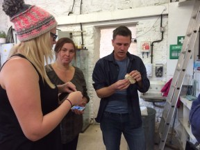 Katie, Helga and Luke discussing the badger skull process.