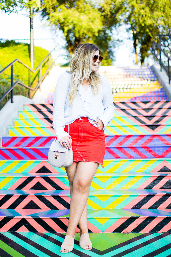 The Glitter Gospel Blog sharing an orange denim skirt and colorful backdrop. Orange denim skirt, topshop, jeffrey campbell pearl heel slides, University of Tennessee, Geometric Steps, Zara, Chloe Drew Dupe