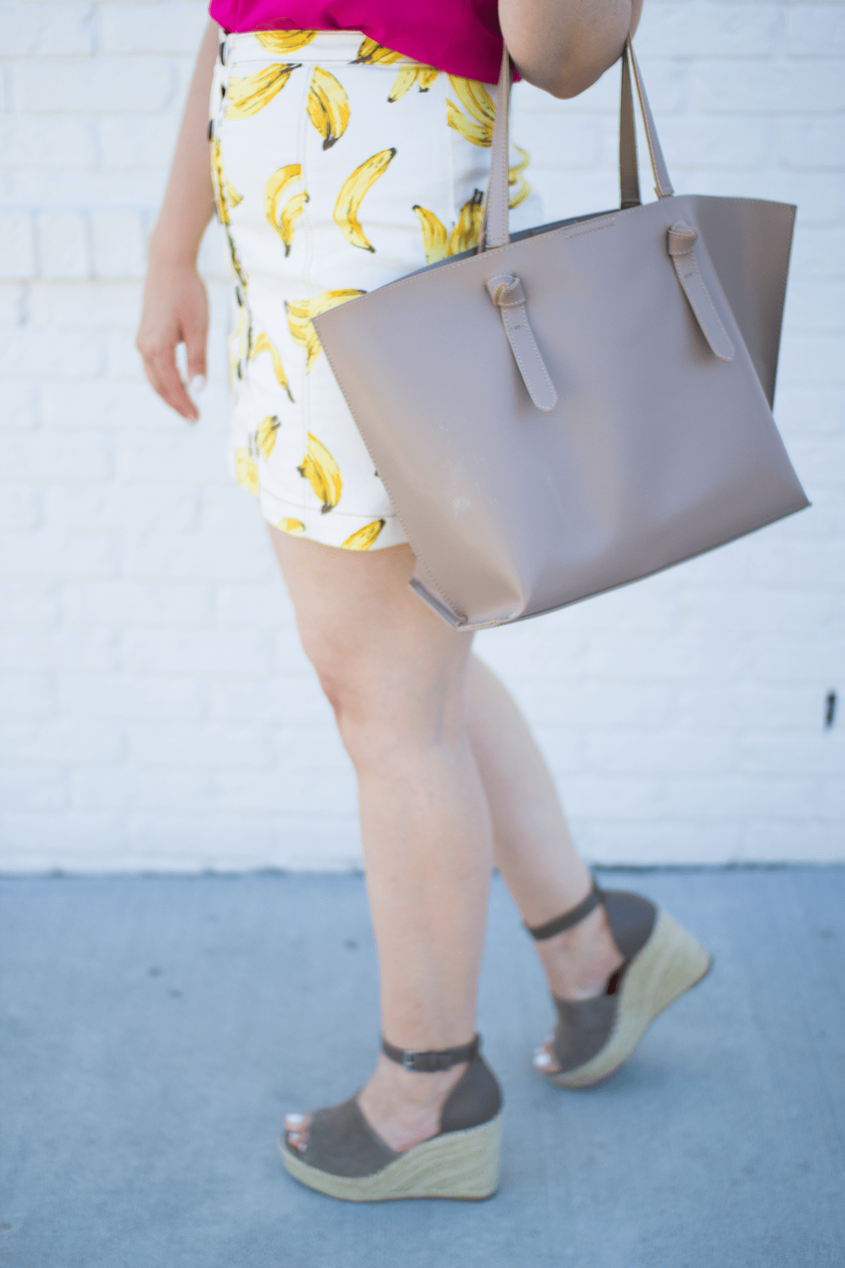 Lacey Anne Douthat from The Glitter Gospel Blog shares her take on the fruit print trend in this banana print skirt from Urban Outfitters. Fruit print, banana print, urban outfitters, topshop, sole society, dsw, baublebar, karen walker, summer style, blonde, espadrilles