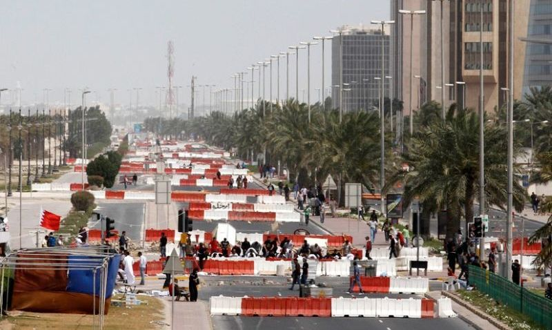 Protesters with the Bahrain Financial Harbor, a center of Islamic Banking (Reuters)