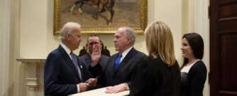 The symbolism of Brennan being sworn in with hand on Constitution without Bill of Rights