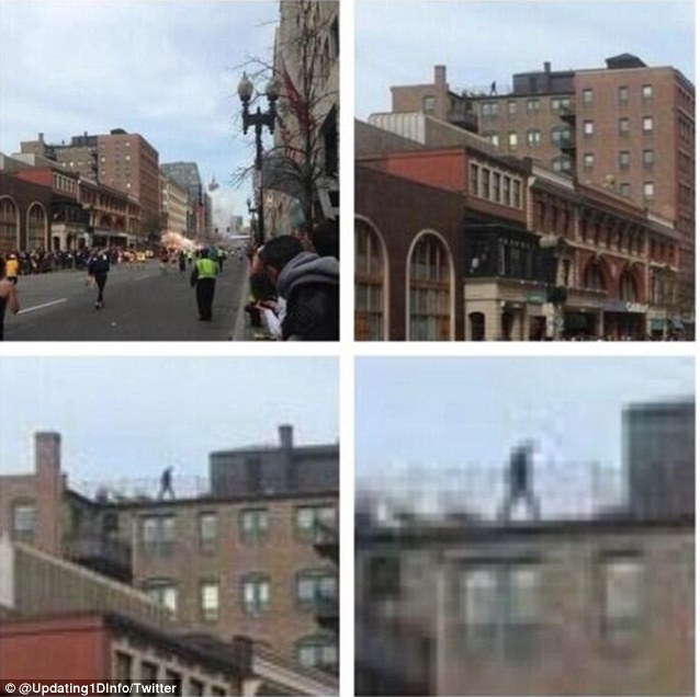 Who is this individual walking on the roof overlooking the blast? This picture posted to Twitter eerily shows person standing directly above the boston bombing