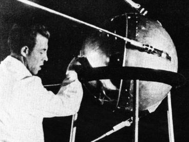 This historic image shows a technician putting the finishing touches on Sputnik 1, humanity's first artificial satellite.  Image Credit: NASA/Asif A. Siddiqi