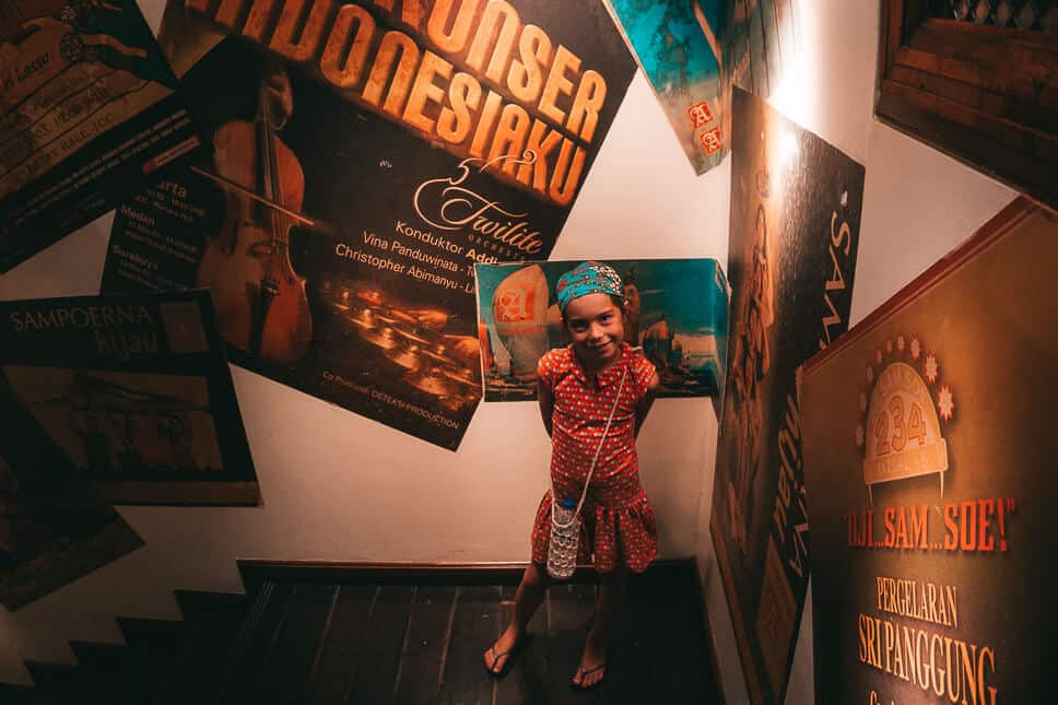 Admiring the old colonial posters in the Sampoerna factory