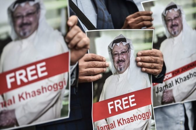 Protestors hold pictures of missing journalist Jamal Khashoggi during a demonstration in front of the Saudi Arabian consulate on October 8, 2018 in Istanbul