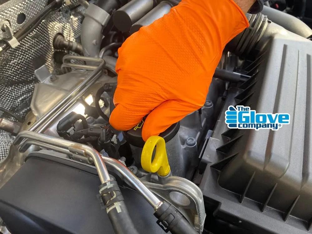 Orange Rocket Extra grip gloves working on car