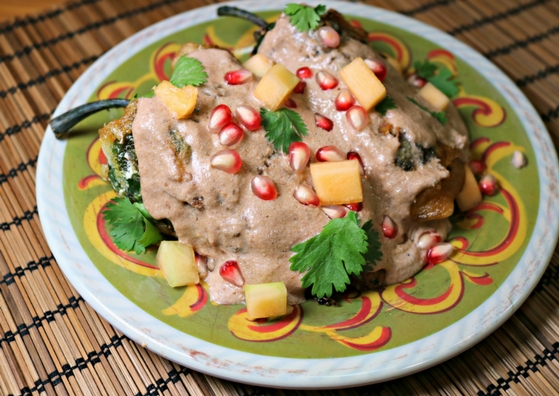 """This recipe for Chiles en Nogada inspired by the Frida Kahlo biopic, """"Frida"""" and features tomatillos, cantaloupe, and pomegranate seeds. Recipe by The Gluttonous Geek."""