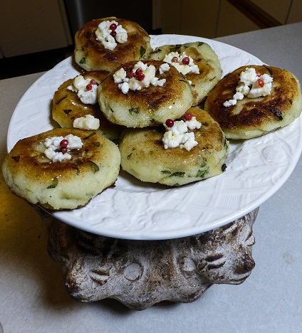 Kronk's Spinach Puffs - Arepas stuffed with Feta Cheese, Spinach, and Pink Peppercorn, inspired by Disney's Emperor New Groove. Recipe by The Gluttonous Geek.