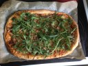 Pulled pork pizza with pine nuts and rocket
