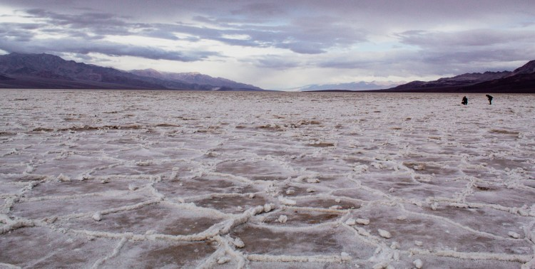 Two photographers in the distance at Badwater Basin in Death Valley National Park
