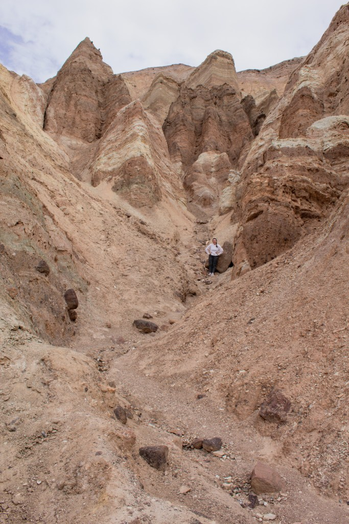 A woman hiking in the canyon area of Death Valley National Park