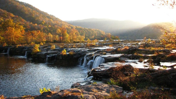 Cascades of waterfalls with autumn foliage at New River Gorge National Park
