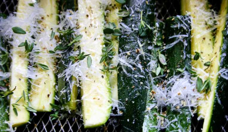Ready to bake zucchini fingers with thyme and Parmesan