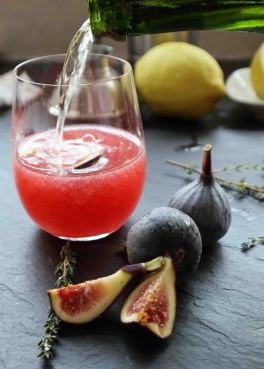 Strain the fig puree, thyme syrup and a bit of sparkling wine- top off with sparkling wine