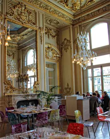 Inside a restaurant with gilded walls and chandeliers at the Orsay Museum