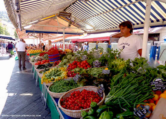French market stall selling vegetables