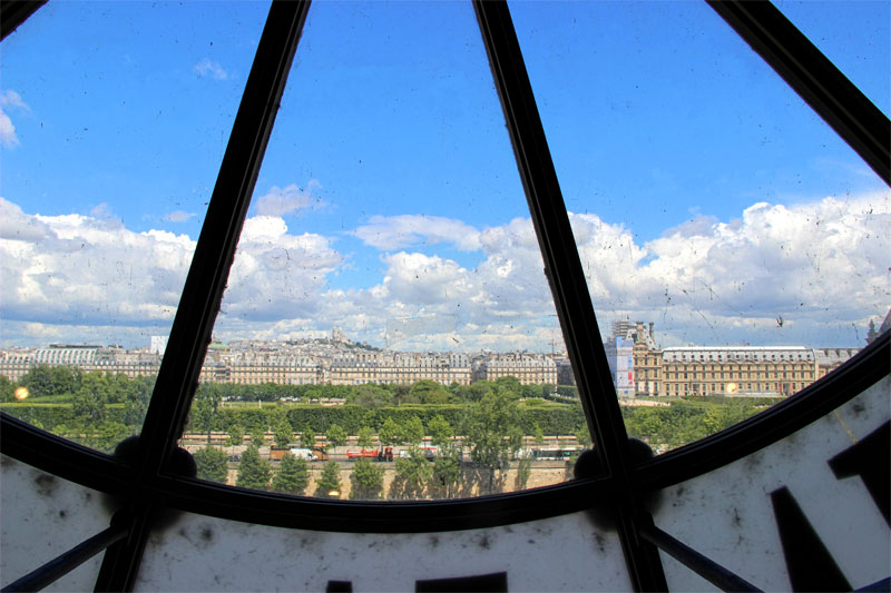 Looking through the giant clock window of the Orsay Museum Paris