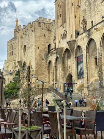 Palace of the Popes Avignon seen from a restaurant in the square before it