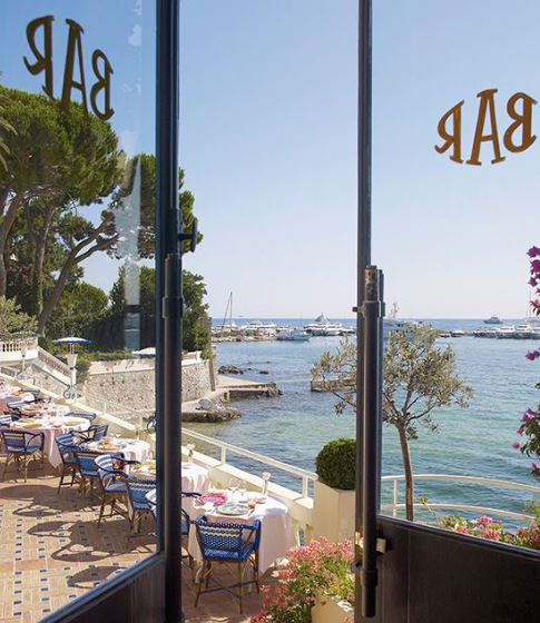 View from the bar of the Hotel Belles-Rives overlooking the blue waters of the Mediterranean Sea