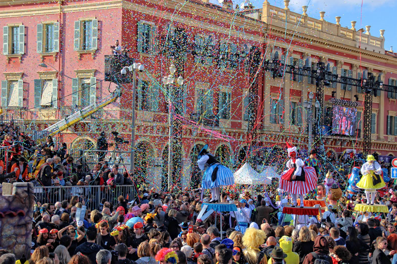 Nice Carnival, thousands of streamers and confetti fall on a lively crowd in the city centre