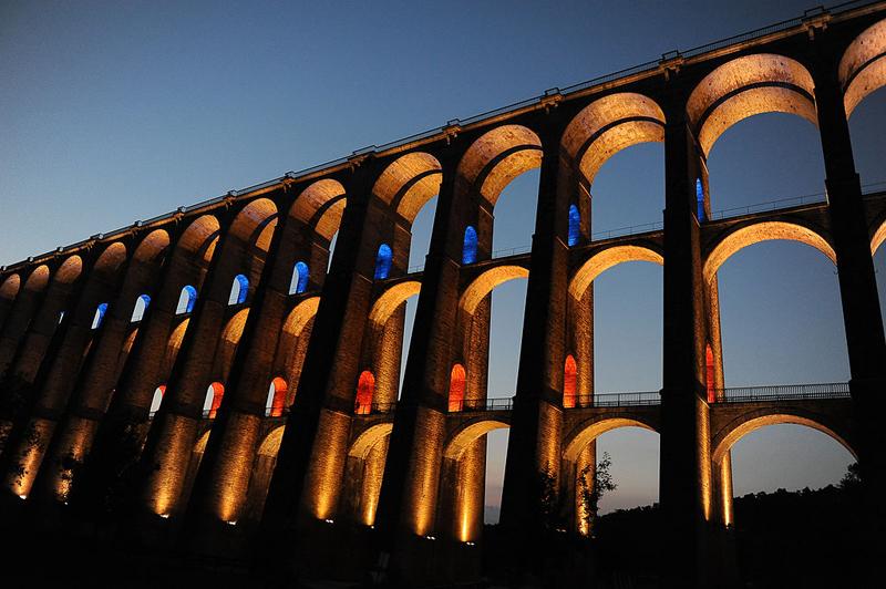 3-storey viaduct lit up at night