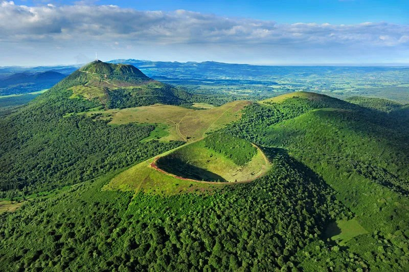 Grass covered dormant volcanoes in Auvergne