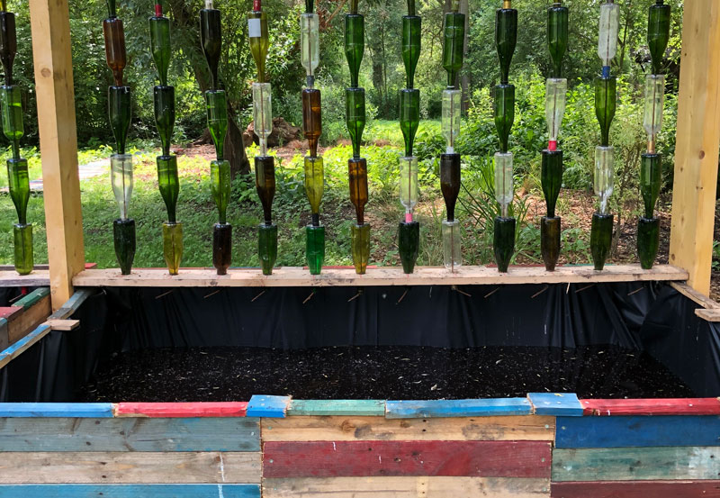 Recycled wine bottles used to collect rain water in an art installation in Amiens, France