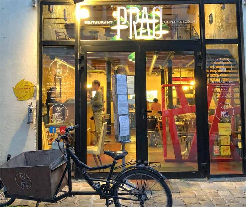 Looking through the window of Prao restaurant in La Rochelle on a dark night, lit from inside