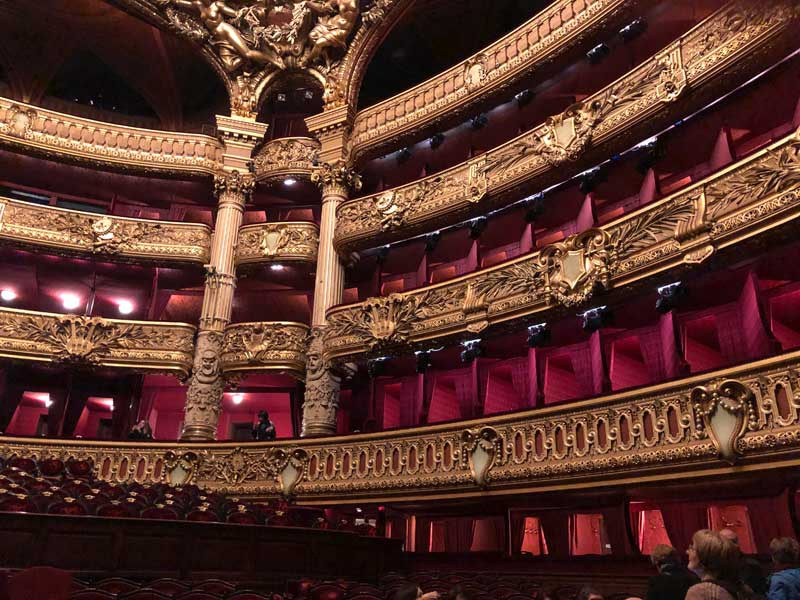 Gilded wood and red velvet seating in the balconies of the Paris Opera House