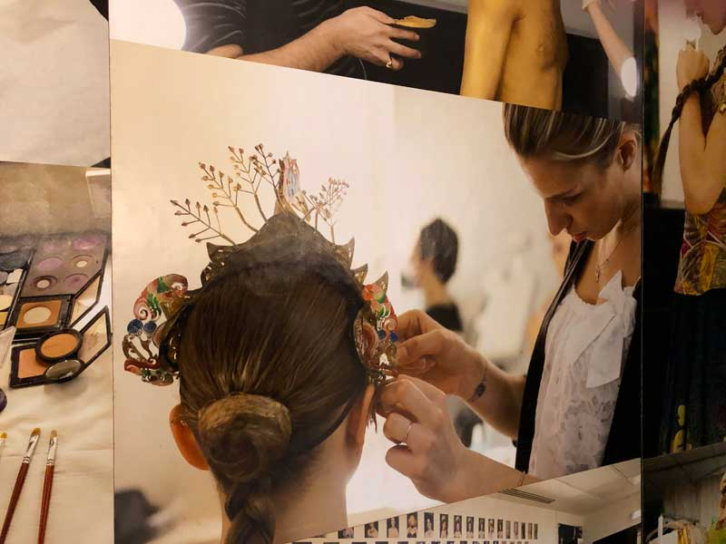 Ballerina having her hair dressed in preparation for a performance at Opera Garnier