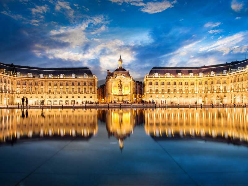 Bordeaux city, view over a mirror of water to elegant stone buildings